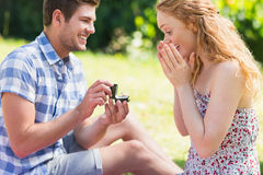 Young man propose to girlfriend Stock Photos