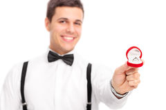 Young man proposing with a diamond ring Royalty Free Stock Image