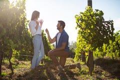Young man proposing girlfriend at vineyard Royalty Free Stock Photography