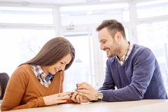 Young man proposing his girlfriend Stock Photos