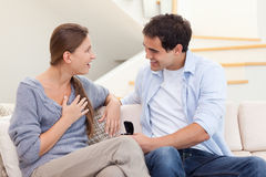 Young man proposing marriage to his girlfriend Royalty Free Stock Photo