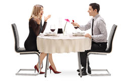 Young man proposing to his girlfriend. Excited young men proposing to his girlfriend on a romantic dinner isolated on white background Stock Images