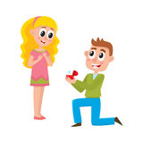 Young man proposing to pretty girl Stock Images