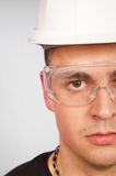 Young man in a protective helmet stock image