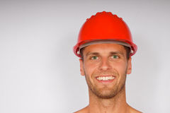 Young man in a protective helmet royalty free stock photography