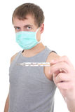 Young man in protective mask with thermometer Stock Images