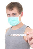 Young man in protective mask with thermometer Royalty Free Stock Photography