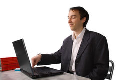 Young man proudly finishes work on laptop. Isolated over white Royalty Free Stock Image