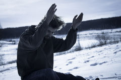 Young man prying in the snow Royalty Free Stock Photography