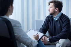 Young man during psychological therapy Stock Image