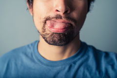 Young man pulling faces Royalty Free Stock Photo