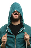 Young Man Pulling Hooded Jacket Over Head Royalty Free Stock Photography