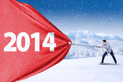 Young man pulling new year of 2014 Royalty Free Stock Photos