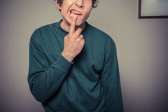 Young man pulling silly faces Royalty Free Stock Photography