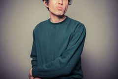Young man pulling silly faces Stock Images