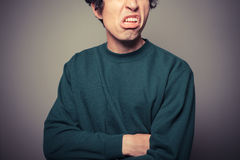 Young man pulling silly faces Stock Photography