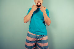 Young man pulling silly faces Royalty Free Stock Photo