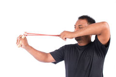 Young man pulling sling shot Stock Photos
