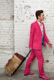 Young man pulls hairy roller bag Royalty Free Stock Image