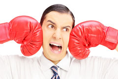 Young man punched by red boxing gloves Royalty Free Stock Photo