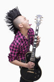 Young man with punk Mohawk playing guitar stock image