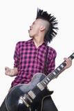 Young man with punk Mohawk playing guitar stock photos