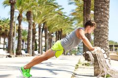 Young man push up against bench Royalty Free Stock Photo