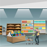 Young man pushing an empty supermarket cart. Customer shopping at supermarket with cart. Vector flat design illustration Stock Images