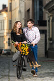 Young man pushing his girlfriend on the bicycle Royalty Free Stock Image