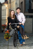 Young man pushing his girlfriend on the bicycle Stock Photo