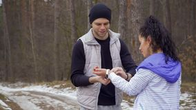 Young man put the fitness tracker on woman`s hand