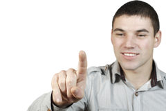 Young man put his finger to the glass Royalty Free Stock Images