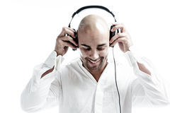 Young man puts on his headphones Royalty Free Stock Images