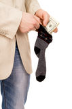 A young man puts money in stockings Stock Photography