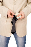 A young man puts money in stockings Royalty Free Stock Image