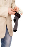 A young man puts money in stockings Stock Photo