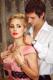 Young Man Puts On Jewelry On Beautiful Woman Stock Image