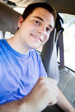 Young man putting on seatbelt Royalty Free Stock Images
