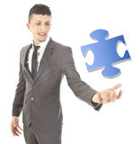 Young man with puzzle piece Stock Photo