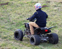 Young man on a quad Stock Photography