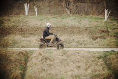 Young man on a quad Stock Image