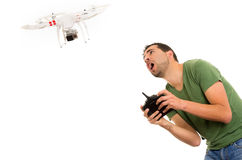 Young man with quadcopter drone. Man flying quadcopter drone isolated on white stock photography