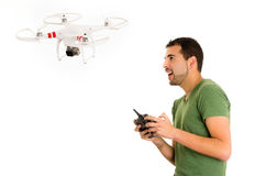 Young man with quadcopter drone Royalty Free Stock Photos