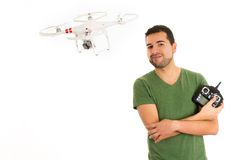 Young man with quadcopter drone. Young man posing with quadcopter drone crossing arms isolated on white stock photo