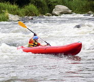Young Man in Raft on White Water Stock Photo