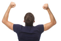 A young man raised his hands up. back view. Isolate Stock Photo