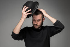 Young man raising his hat  in respect and Royalty Free Stock Photo