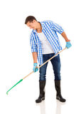Young man raking Stock Photography
