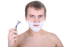 Young man with  razor and shaving foam Royalty Free Stock Image
