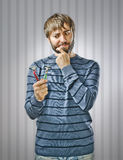 Young Man with Razors Stock Photography